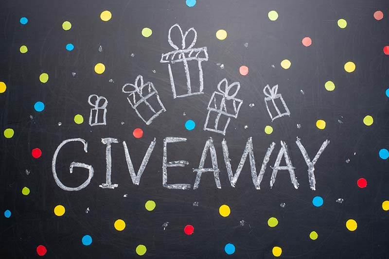Giveaway text on chalkboard raffle przizes
